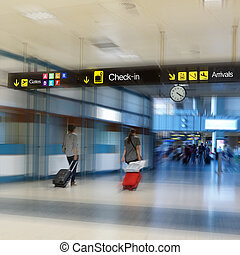 Airline Passengers in an Airport - Airline Passengers in an...