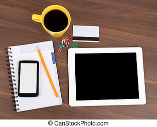 Blank copybook with tablet and smartphone on wooden table