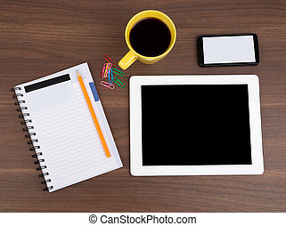 Blank copybook with tablet and coffee on wooden table