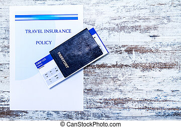 Travel insurance policy booklet with a boarding pass and a...