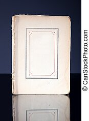 Old book page with vintage frame reflected