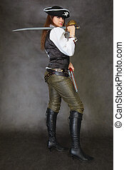 Woman dressed as pirate on black with sword