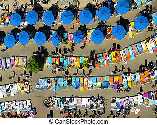 Sun chairs and umbrellas at water park