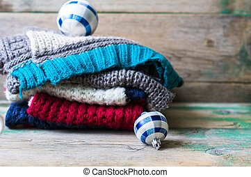 Christmas time - Christmas Balls on Knitted Gifts on wooden...