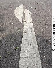 Arrow sign - Left arrow sign on a street