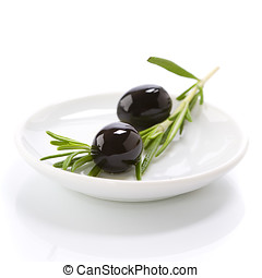Olive branch and olive oil on white plate