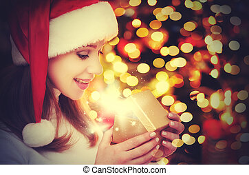 happy mysterious  woman with magic Christmas  gifts