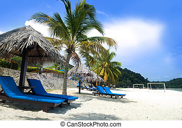 Relaxing on beach. - Deck chairs on Teluk Chempedak,...
