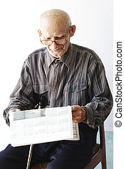 Senior man with newspaper - Senior man in eyeglasses with...