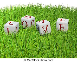 Red letters Love on bricks on green grass