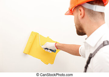 Handsome male painter is working in house