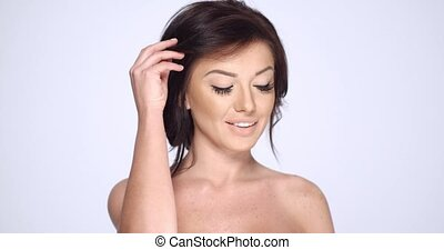 Happy Smiling Brunette Woman Posing on White