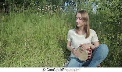 Women playing on Jambe Drum on nature, HD