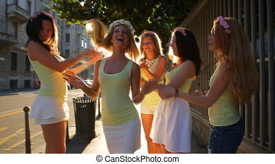 beautiful girls laughing at bachelorette party in street