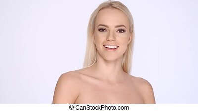 Cute Smiling Blond Girl Posing in Studio