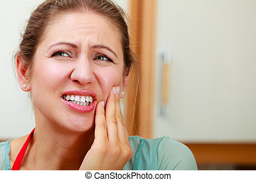 Woman suffering from toothache tooth pain. - Mature woman...