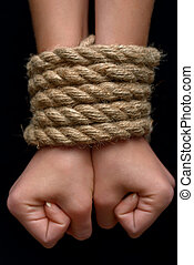 Young girl tied with rope - Help me Close up of hand of...