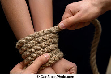 Young girl tied with rope - Do not do it Close up of man...