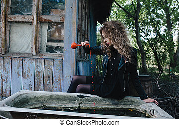 Vintage witch with elixir in hand - Vintage witch performs...