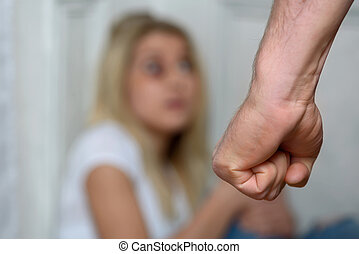Young girl being chastise - Cruel behavior Close up of fist...