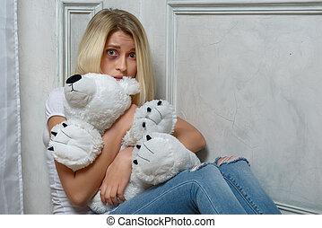 Depressed girl sitting on the floor - help me Depressed...