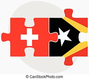 Switzerland and East Timor Flags in puzzle isolated on white...