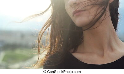 Wind blowing hair of beautiful young woman - Close up...