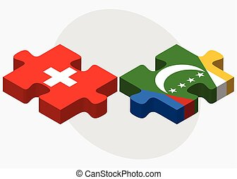 Switzerland and Comoros Flags in puzzle isolated on white...