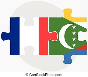 France and Comoros Flags in puzzle isolated on white...