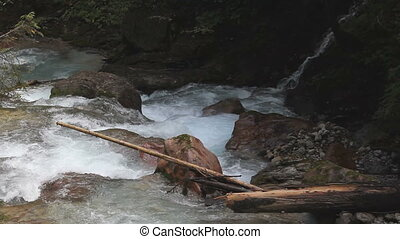 mountain stream - water rushing through a mountain stream in...