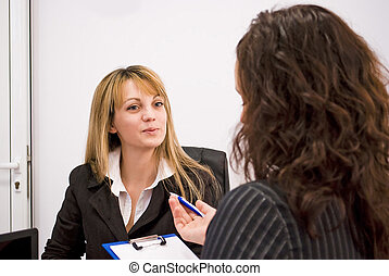job interview - young woman being interviewed for a job