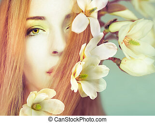 Beautiful woman with spring flowers