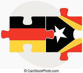 Germany and East Timor Flags in puzzle isolated on white...