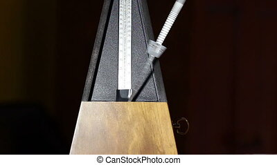 Metronome Tight Shot Arm Moving - Tight Shot Of Metronome...