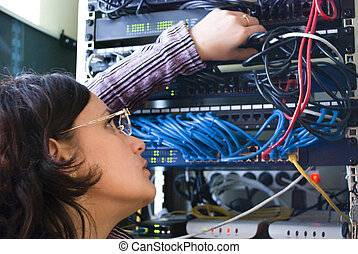 engineer - young woman repairs computer hardware