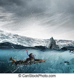 Woman under water - Young businesswoman in suit and diving...