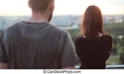 beautiful couple embrace on background of the city