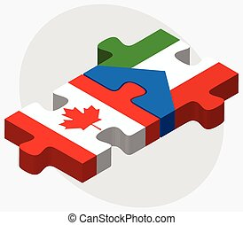 Canada and Equatorial Guinea Flags in puzzle isolated on...