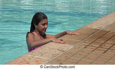 Woman Climbing out of Swimming Pool