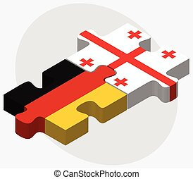 Germany and Georgia Flags in puzzle isolated on white...