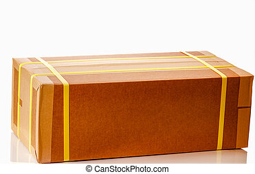 Brown Packing Box - Brown cardboard shipping box taped and...