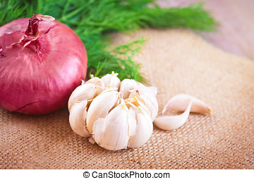 Red onions, dill and garlic on a table - Red onions, dill...