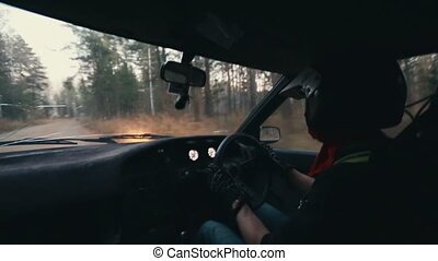 Rally car driver during race