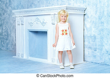 angel child - Little angelic girl in white dress standing by...