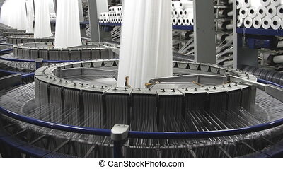 Textile industry - spinning machine in a factory - Textile...