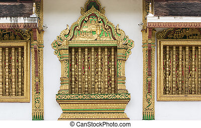 Carved wooden window at the temple in Luang Prabang, Laos. -...