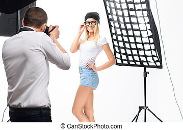 Female model poses professionally during photoshoot -...