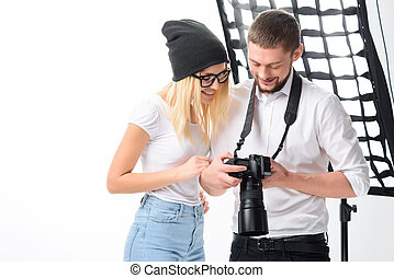 Model and photographer are looking through the shots - Time...