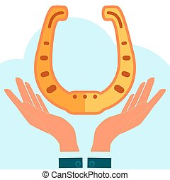 Golden horseshoe in hands