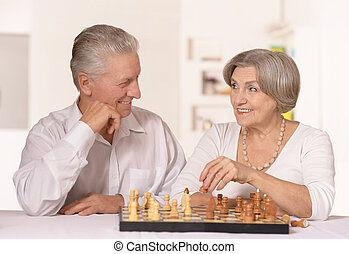Senior couple playing chess